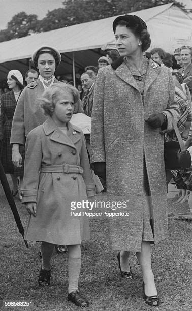 Queen Elizabeth II and her daughter Princess Anne followed by Princess Margaret attend the final day of the Royal Windsor Horse Show in Home Park...