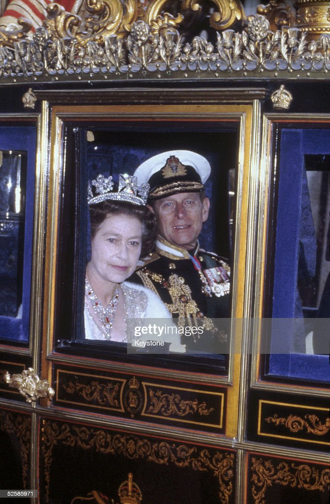 Queen Elizabeth II and her husband Prince Philip, Duke of Edinburgh on their way to the state opening of Parliament, London, 1983.