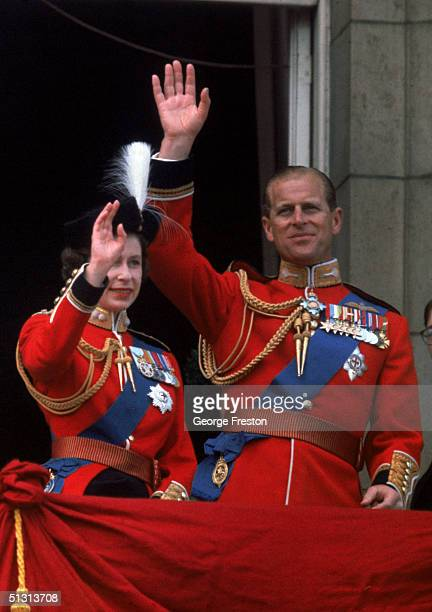 Queen Elizabeth II and her husband Prince Philip Duke of Edinburgh waving frm the balcony at Buckingham Palace after a Trooping of the Colour...
