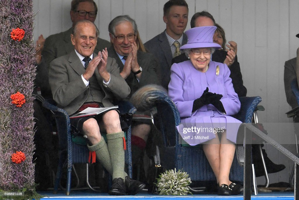 queen-elizabeth-ii-and-her-husband-prince-philip-watch-performers-at-picture-id598891446