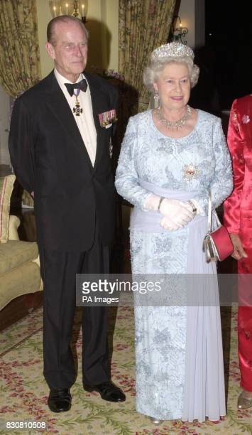 Queen Elizabeth II and her husband the Duke of Edinburgh before a banquet that she hosted in Kingston with Governor General Sir Howard Cooke her...