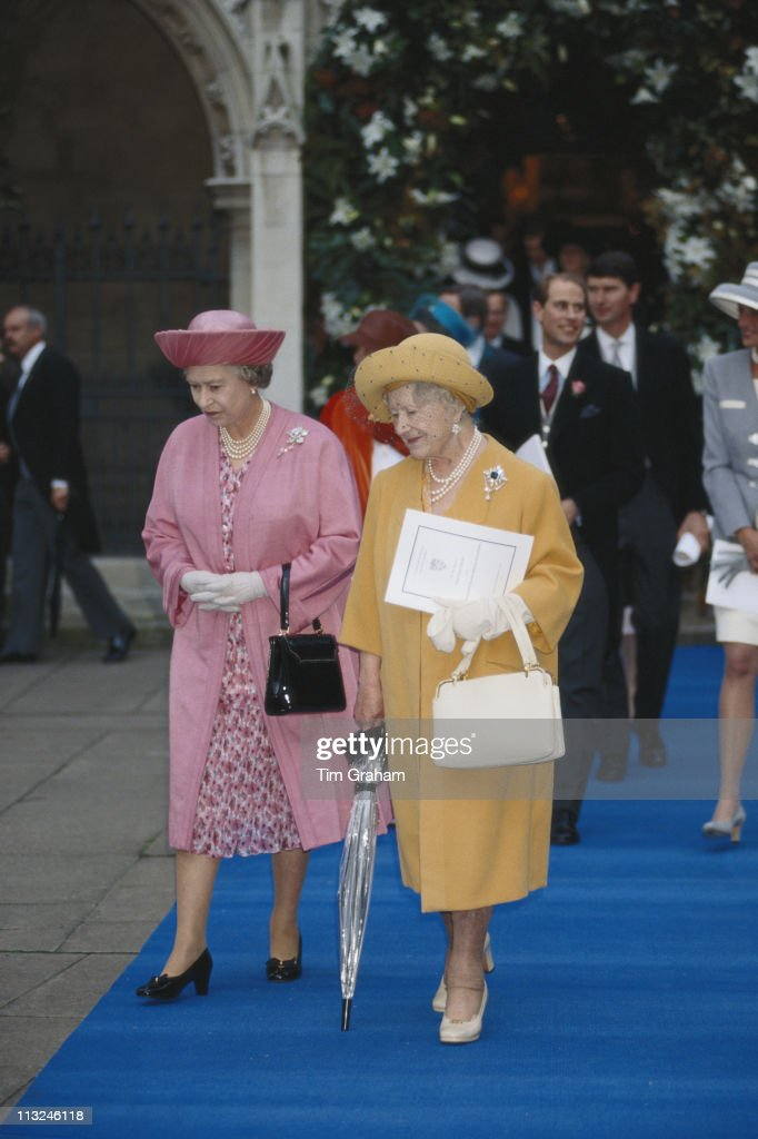 Queen Elizabeth II and her mother, The Queen Mother (1900 - 2002), attending the wedding of Viscount Linley and Serena Stanhope, at the Church of St. Margaret, in the grounds of Westminster Abbey, on Parliament Square, London, England, Great Britain, 8 October 1993.