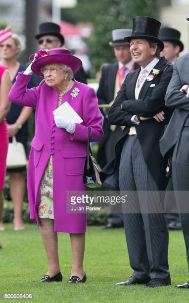 Queen Elizabeth II and her racing manager John Warren attend day 5 of Royal Ascot at Ascot Racecourse on June 24 2017 in Ascot England