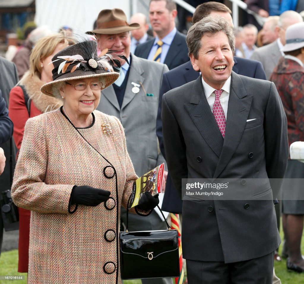 Queen <a gi-track='captionPersonalityLinkClicked' href=/galleries/search?phrase=Elizabeth+II&family=editorial&specificpeople=67226 ng-click='$event.stopPropagation()'>Elizabeth II</a> and her racing manager <a gi-track='captionPersonalityLinkClicked' href=/galleries/search?phrase=John+Warren+-+Racing+Advisor&family=editorial&specificpeople=14677107 ng-click='$event.stopPropagation()'>John Warren</a> attend the Dubai Duty Free Raceday at Newbury Racecourse on April 19, 2013 in Newbury, England.