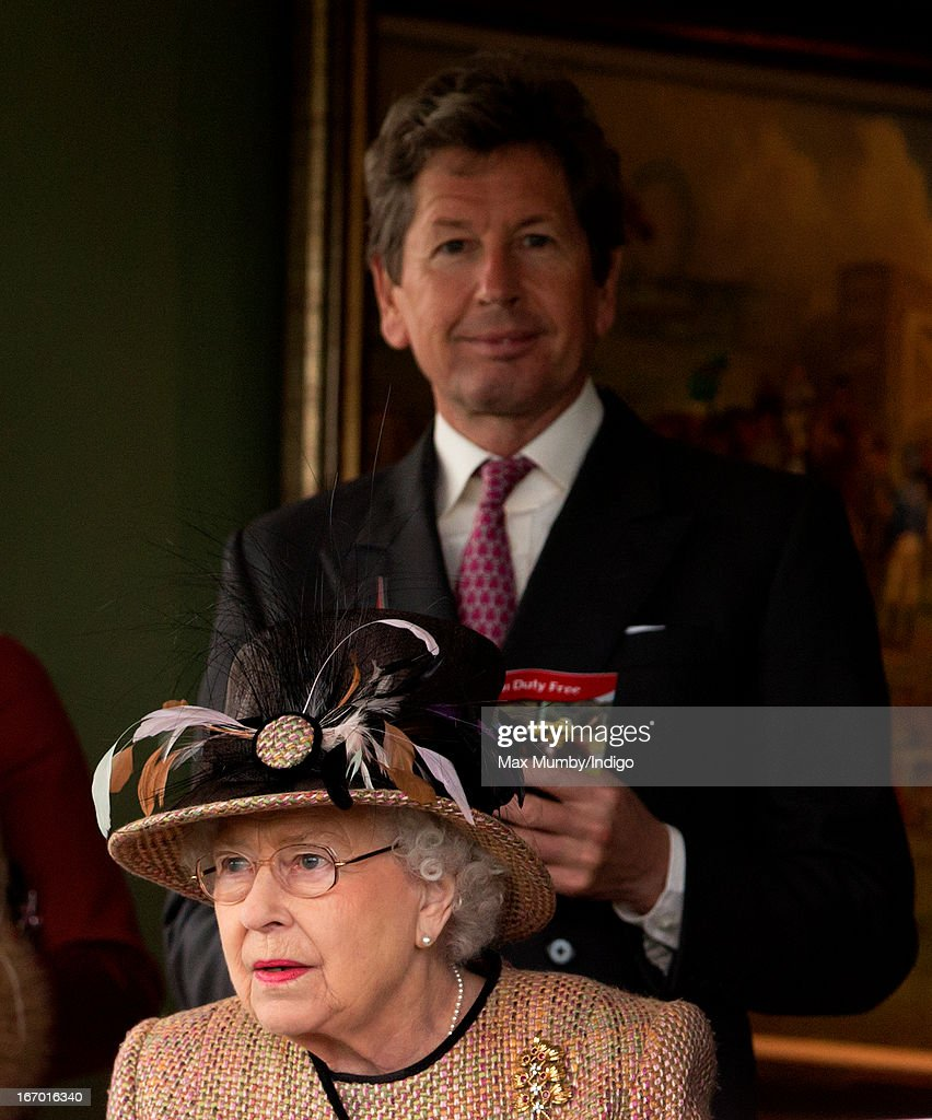 Queen Elizabeth II and her racing manager John Warren watch the racing as they attend the Dubai Duty Free Raceday at Newbury Racecourse on April 19, 2013 in Newbury, England.