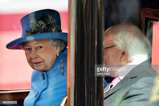 Queen Elizabeth II and Irish President Michael D Higgins ride in a horsedrawn carriage during a ceremonial welcome at Windsor Castle on April 8 2014...