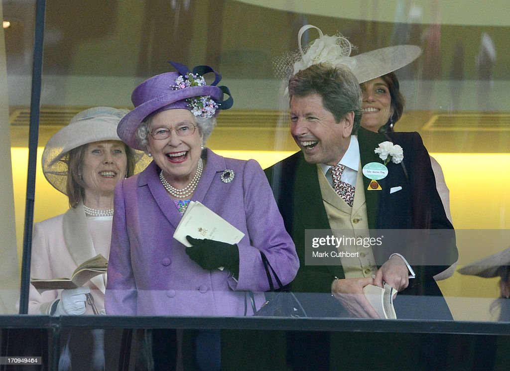 Queen <a gi-track='captionPersonalityLinkClicked' href=/galleries/search?phrase=Elizabeth+II&family=editorial&specificpeople=67226 ng-click='$event.stopPropagation()'>Elizabeth II</a> and <a gi-track='captionPersonalityLinkClicked' href=/galleries/search?phrase=John+Warren+-+Racing+Advisor&family=editorial&specificpeople=14677107 ng-click='$event.stopPropagation()'>John Warren</a> cheer on her horse 'Estimate' to win The Gold Cup on Ladies Day on Day 3 of Royal Ascot at Ascot Racecourse on June 20, 2013 in Ascot, England.