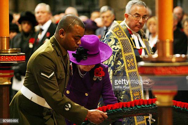 Queen Elizabeth II and Lance Corporal Johnson Beharry VC lay a wreath during a memorial service to mark the passing of the World War I generation at...