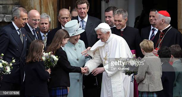 Queen Elizabeth II and Pope Benedict XVI meet school children outside the Palace of Holyroodhouse the Queen's official residence in Scotland on...