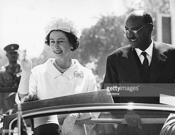 HM Queen Elizabeth II and President El Tigani ElMahi in a car together on the state drive from Khartoum Airport on a royal visit Sudan February 11th...