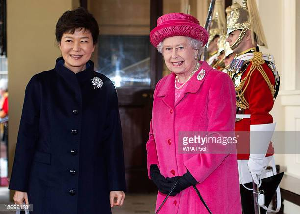 Queen Elizabeth II and President of South Korea Park GeunHye pose together outside the Grand Entrance on arrival by state carriage at Buckingham...