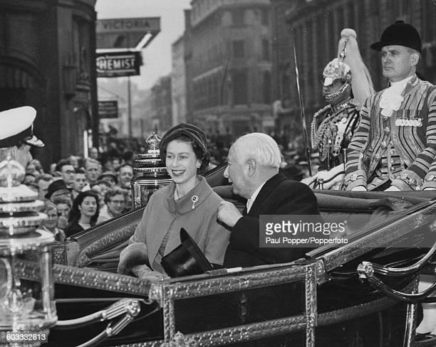 Queen Elizabeth II and President of the Federal Republic of Germany Theodor Heuss ride together in the state carriage in a procession from Victoria...