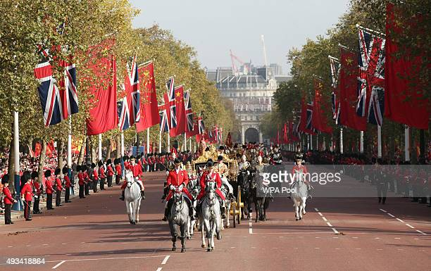 Queen Elizabeth II and President of The People's Republic of China Xi Jinping ride in the Diamond Jubilee State Coach along The Mall after the...