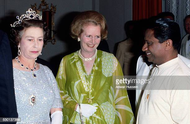 Queen Elizabeth II and Prime Minister Margaret Thatcher attend a ball to celebrate the Commonwealth Heads of Government Meeting hosted by President...