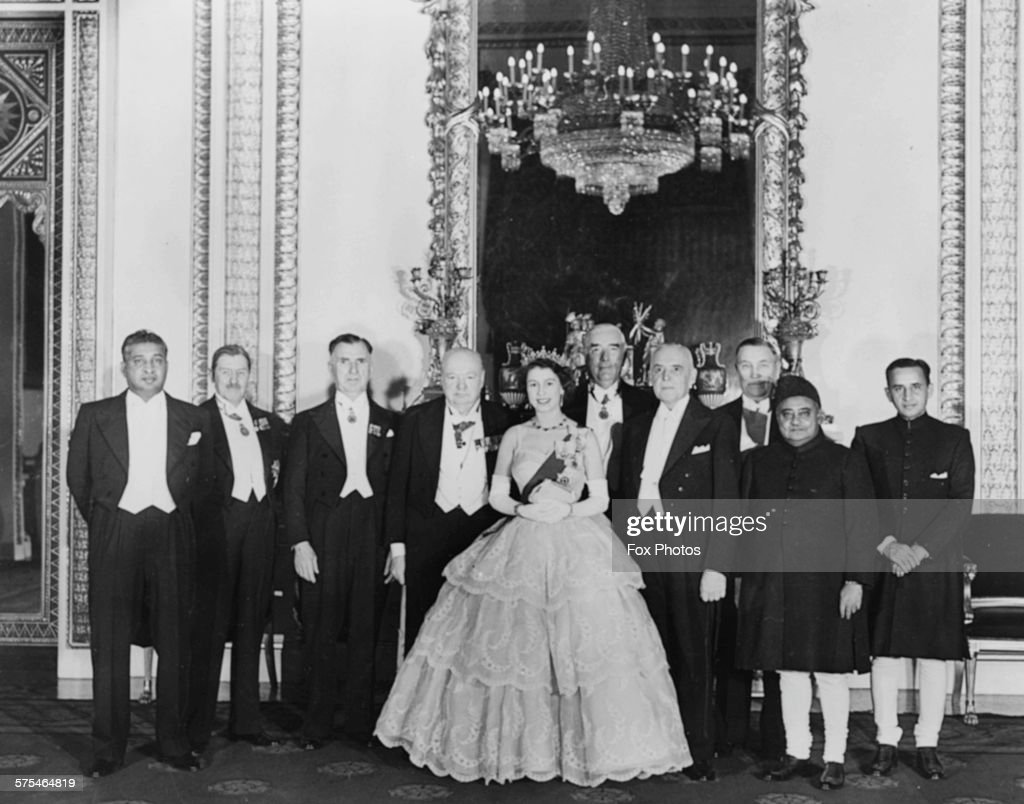 Queen Elizabeth II and Prime Minister Winston Churchill posing for a photograph with the Commonwealth dignitaries attending a dinner at Buckingham...