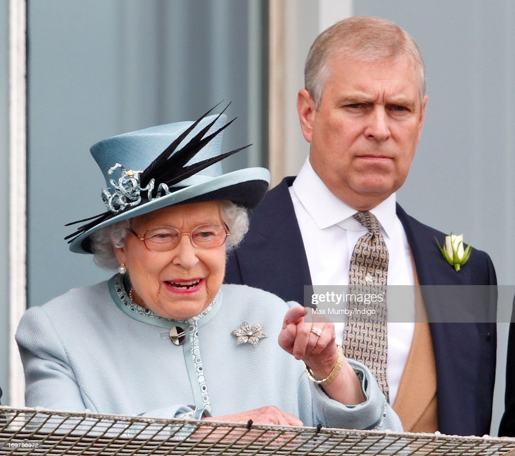 Queen Elizabeth II and Prince Andrew, Duke of York watch the racing as they attend Derby Day of the Investec Derby Festival at Epsom Racecourse on June 1, 2013 in Epsom, England.