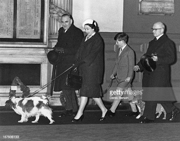 Queen Elizabeth II and Prince Charles walk through Liverpool Street Station in London with their dogs having returned by train from Sandringham after...