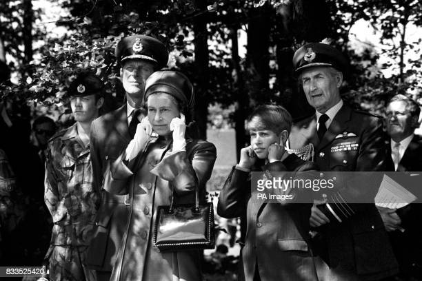 Queen Elizabeth II and Prince Edward shield their ears at RAF Finningley near Doncaster during the Silver Jubilee Review of the Royal Air Force