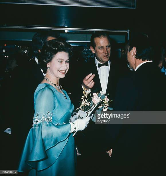 Queen Elizabeth II and Prince Philip attend the UK film premiere of 'Murder on the Orient Express' at the ABC Cinema Shaftesbury Avenue London 1974