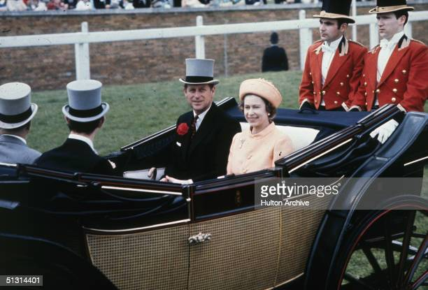 Queen Elizabeth II and Prince Philip attending Ascot races in an open top carriage1970