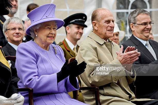 Queen Elizabeth II and Prince Philip Duke of Edinburgh applaud a stage performance during a visit to Exeter city centre on May 02 2012 in Exeter...