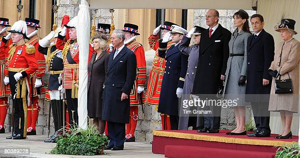 Queen Elizabeth II and Prince Philip Duke of Edinburgh are accompanied by Camilla Duchess of Cornwall and Prince Charles Prince of Wales to welcome...