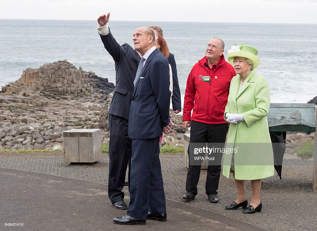 Queen <a gi-track='captionPersonalityLinkClicked' href=/galleries/search?phrase=Elizabeth+II&family=editorial&specificpeople=67226 ng-click='$event.stopPropagation()'>Elizabeth II</a> and <a gi-track='captionPersonalityLinkClicked' href=/galleries/search?phrase=Prince+Philip&family=editorial&specificpeople=92394 ng-click='$event.stopPropagation()'>Prince Philip</a>, Duke Of Edinburgh are escorted by Bob Brown from the National Trust of Northern Ireland and guide Neville Mconachie during a visit to the Giants Causeway on June 28, 2016 in County Antrim, Northern Ireland, United Kingdom.