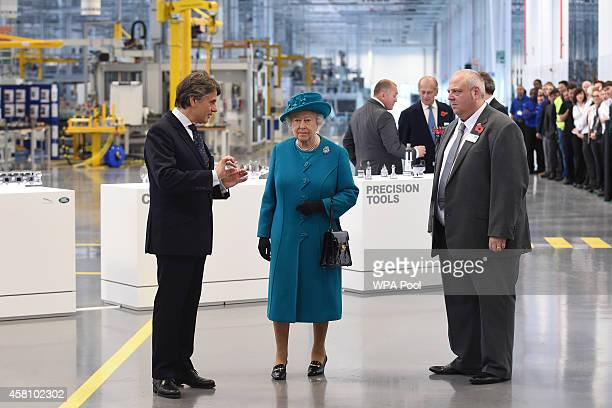 Queen Elizabeth II and Prince Philip Duke of Edinburgh are given a tour of the factory by chief executive Dr Ralf Speth and chief designer Gerry...