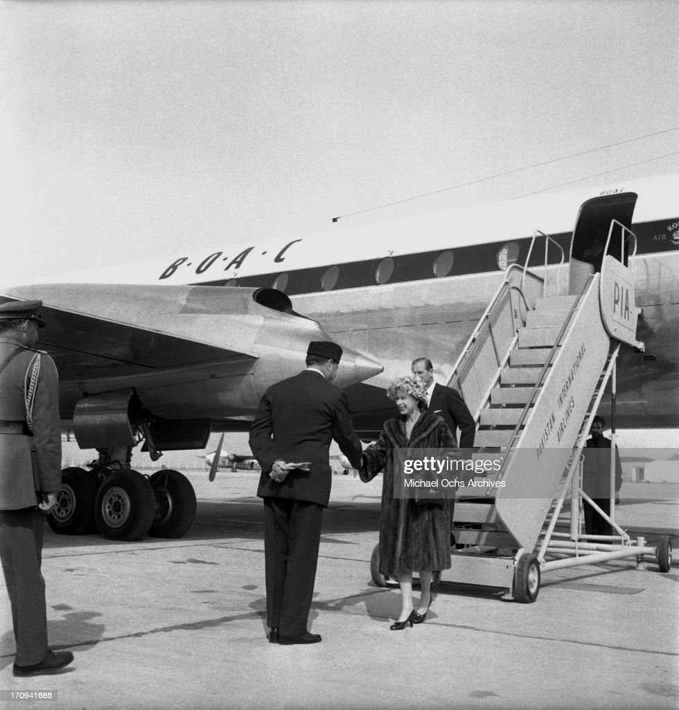 Queen Elizabeth II and Prince Philip Duke of Edinburgh are greeted at the airport by President Ayub Khan on February 6 1961 in Rawalpindi Pakistan