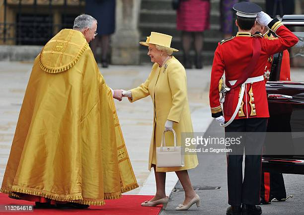Queen Elizabeth II and Prince Philip Duke of Edinburgh are greeted by The Right Reverend Dr John Hall Dean of Westminster as they arrive to attend...