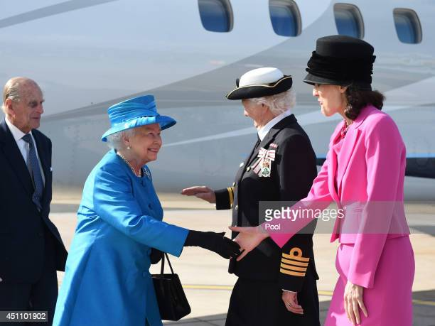 Queen Elizabeth II and Prince Philip Duke of Edinburgh are greeted by Lord Lieutenant of Belfast Mary Peters and Secretary of State Theresa Villiers...