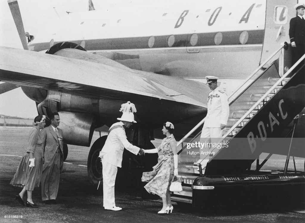 Queen Elizabeth II and Prince Philip Duke of Edinburgh are greeted by Sir Alexander Hood Governor of Bermuda upon their arrival at Kindley Field in...