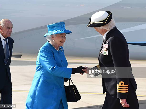 Queen Elizabeth II and Prince Philip Duke of Edinburgh are greeted Lord Lieutenant of Belfast Mary Peters as they arrive at George Best Belfast City...