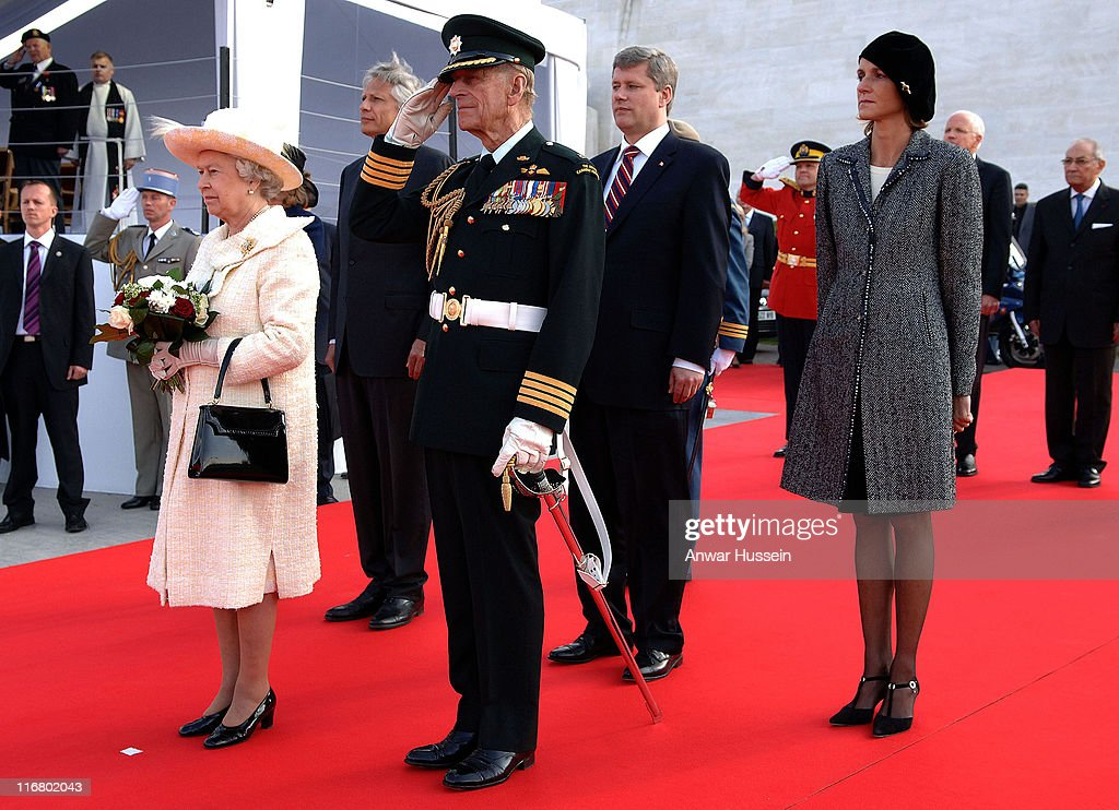 Queen <a gi-track='captionPersonalityLinkClicked' href=/galleries/search?phrase=Elizabeth+II&family=editorial&specificpeople=67226 ng-click='$event.stopPropagation()'>Elizabeth II</a> and Prince Philip, Duke of Edinburgh are joined by French Prime Minister <a gi-track='captionPersonalityLinkClicked' href=/galleries/search?phrase=Dominique+de+Villepin&family=editorial&specificpeople=548074 ng-click='$event.stopPropagation()'>Dominique de Villepin</a>(behind Queen), his wife Marie-Laure (right in beret) and Canadian Prime M inister Stephen Harper (behind Duke) as they stand to attention during a ceremony to mark the 90th anniversary of the Battle of Vimy Ridge, in which more than 3,500 Canadian troops were killed, in northern France on April 9, 2007. Photo: Anwar Hussein