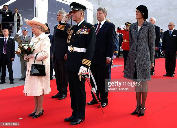 Queen Elizabeth II and Prince Philip Duke of Edinburgh are joined by French Prime Minister Dominique de Villepin his wife MarieLaure and Canadian...