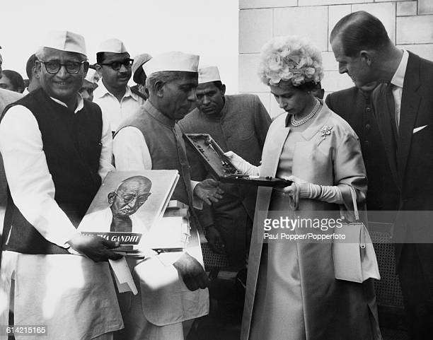 Queen Elizabeth II and Prince Philip Duke of Edinburgh are shown souvenirs at the tomb and shrine of Mahatma Gandhi by Prime Minister of India...