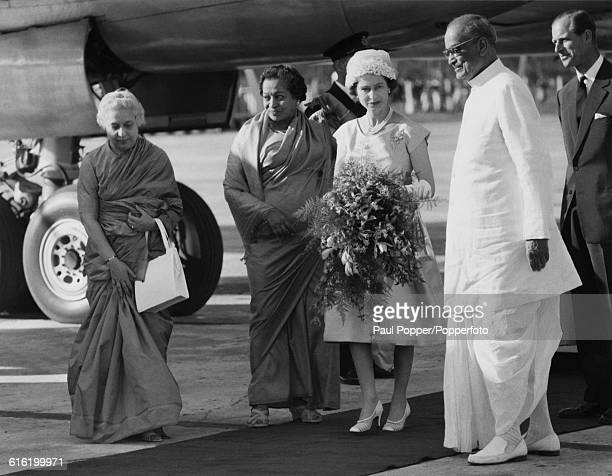 Queen Elizabeth II and Prince Philip Duke of Edinburgh are welcomed by from left Vijaya Lakshmi Pandit Governor of West Bengal Padmaja Naidu and...