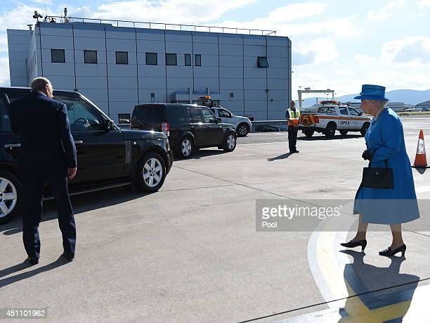 Queen Elizabeth II and Prince Philip Duke of Edinburgh arrive at George Best Belfast City Airport on June 23 2014 in Belfast Northern Ireland The...