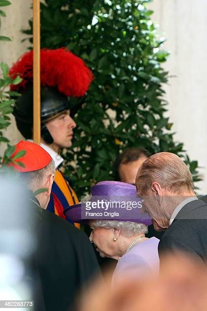 Queen Elizabeth II and Prince Philip Duke of Edinburgh arrive at the Paul VI Hall for a meeting with Pope Francis on April 3 2014 in Vatican City...