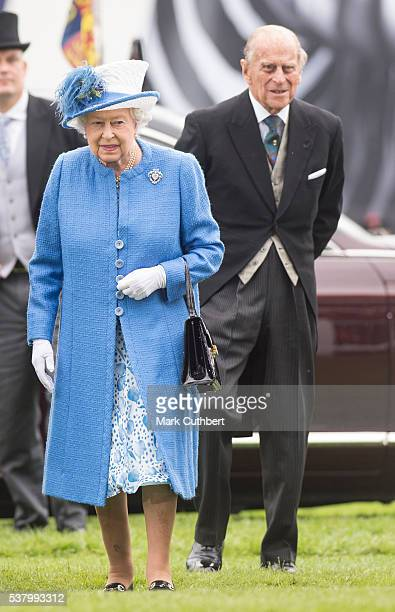 Queen Elizabeth II and Prince Philip Duke of Edinburgh arrive at The Investec Derby Festival at Epsom Racecourse on June 4 2016 in Epsom England