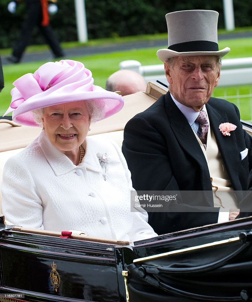Queen Elizabeth II and Prince Philip, Duke of Edinburgh arrive by carriage on Day 2 of Royal Ascot at Ascot Racecourse on June 15, 2011 in Ascot, England.