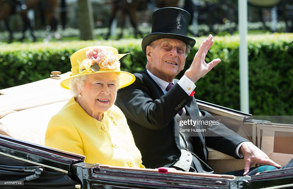 Queen Elizabeth II and Prince Philip, Duke of Edinburgh arrive by carriage on day 4 of Royal Ascot at Ascot Racecourse on June 19, 2015 in Ascot, England.
