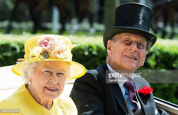 Queen Elizabeth II and Prince Philip Duke of Edinburgh arrive by carriage on day 4 of Royal Ascot at Ascot Racecourse on June 19 2015 in Ascot England