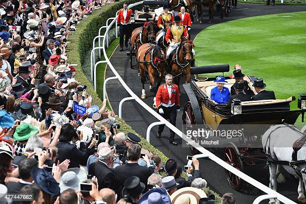 Queen Elizabeth II and Prince Philip Duke of Edinburgh arrive for Day Two at the Royal Ascot Racecourse on June 17 2015 in London England The Royal...
