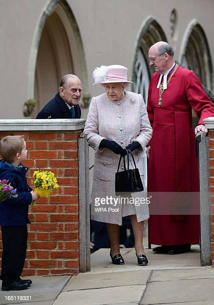 Queen Elizabeth II and Prince Philip Duke of Edinburgh arrive for the Easter service at St George's Chapel in the grounds of Windsor Castle on March...