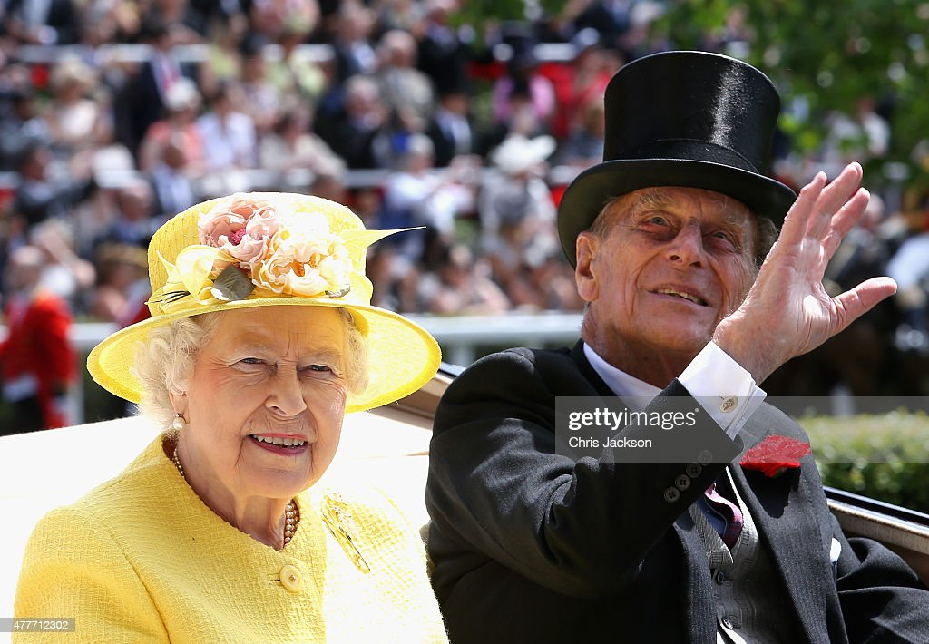 Queen Elizabeth II and Prince Philip, Duke of Edinburgh arrive in the Royal Carriage into the parade ring on day 4 of Royal Ascot at Ascot Racecourse on June 19, 2015 in Ascot, England.
