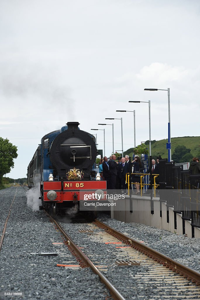 Queen Elizabeth II and Prince Philip, Duke Of Edinburgh arrive on a steam train to open the new Bellarena Station village on June 28, 2016 in Bellarena, Northern Ireland.