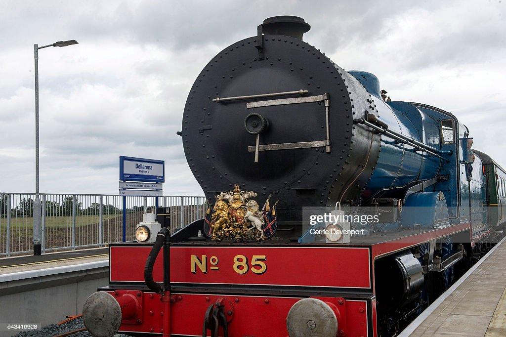 Queen Elizabeth II and Prince Philip, Duke Of Edinburgh arrive on a steam train to open the new Bellarena Station village on June 28, 2016 in Bellarena, Northern Ireland.