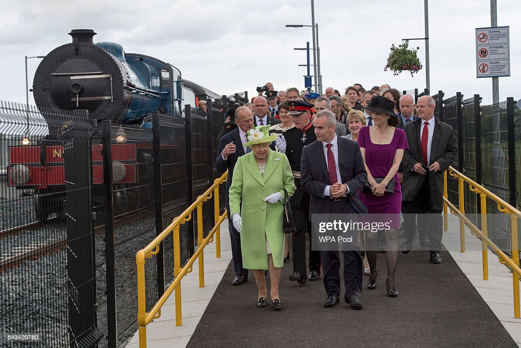 Queen <a gi-track='captionPersonalityLinkClicked' href=/galleries/search?phrase=Elizabeth+II&family=editorial&specificpeople=67226 ng-click='$event.stopPropagation()'>Elizabeth II</a> and Prince Philip, Duke Of Edinburgh arrive on a steam train to open the new Bellarena Station village after travelling from Coleraine Railway Station on June 28, 2016 in Bellarena, Northern Ireland, United Kingdom. The Queen and The Duke of Edinburgh unveiled a plaque to mark the opening of the Bellarena Railway Station before they departed Northern Ireland.