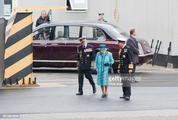 Queen Elizabeth II and Prince Philip Duke of Edinburgh arrive to name the Royal Navy's new aircraft carrier HMS Queen Elizabeth on July 4 2014 in...